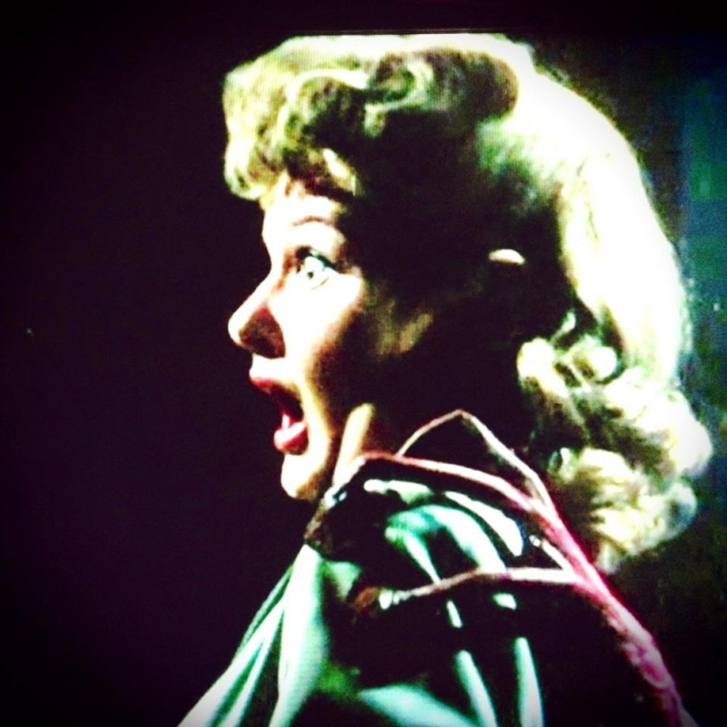 My crudely done frame grab from the 1953 War of the Worlds show thirtysomething girl-next-door Ann Robinson as Sylvia Van Buren with mouth agape as she feels an alien hand on her shoulder.