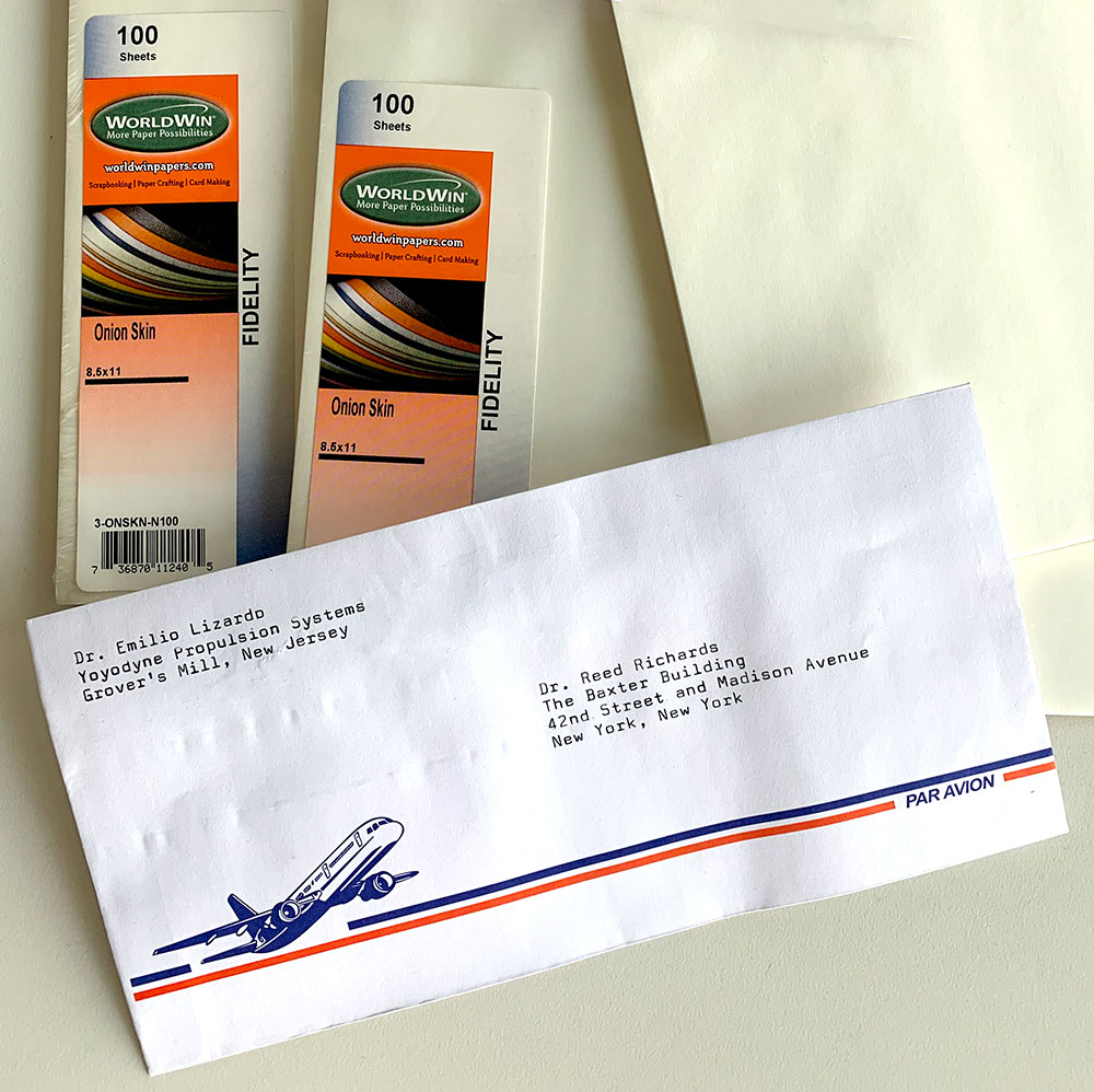 Photo of envelopes and paper with a retro design designed to emulate lightweight products use when airmail cost a lot.