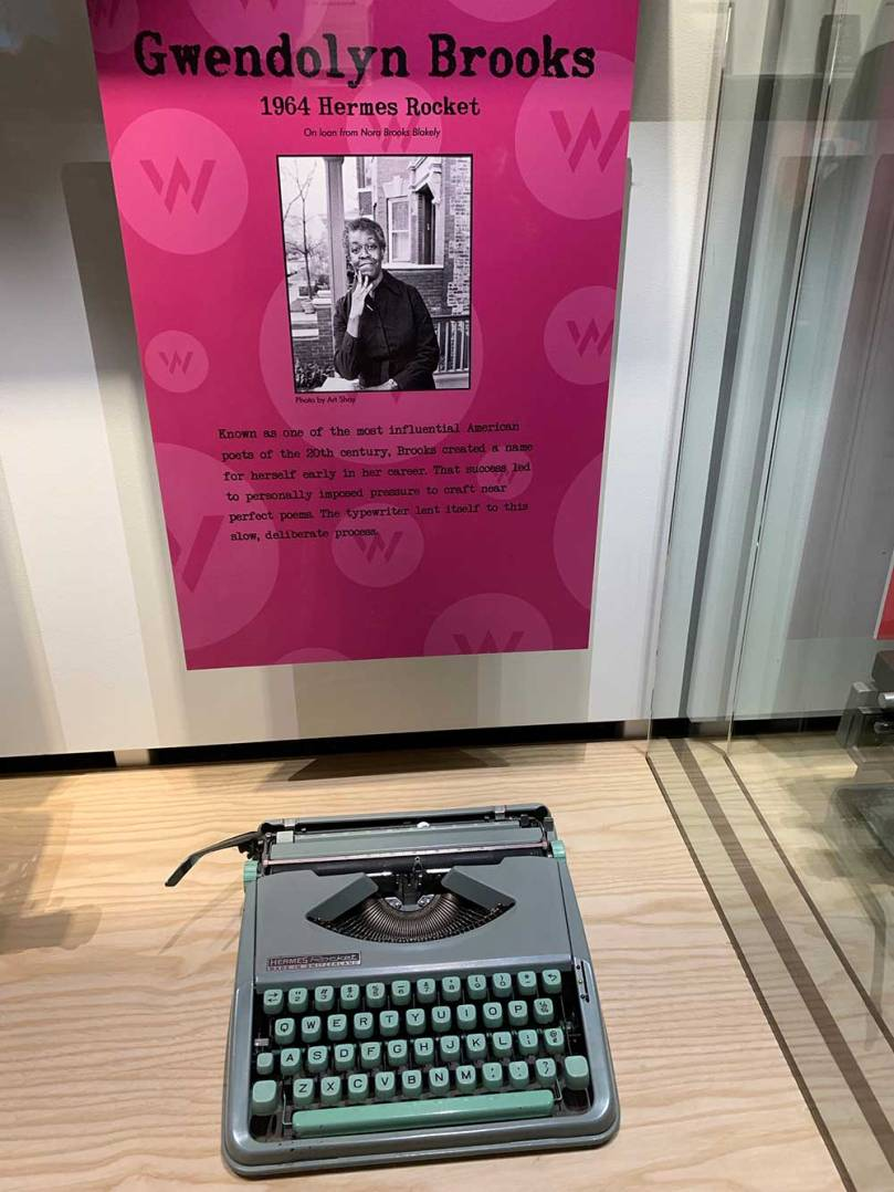 Museum display shows Gwendolyn Brooks' Hermes Rocket typewriter. The typewriter is streamlined and graceful, just like Brooks' writing.